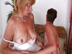 Mature lesbian dildo and strap-on action