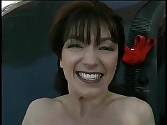 Mature brunette gets her pussy spread at hand direct then fucks