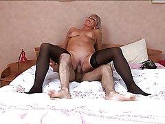 Hot Russian full-grown in stockings fuck at bedroom