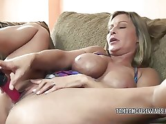 Mature slut Leeanna Main ingredient lifts the brush skirt to fuck a dildo