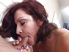 Hot mature brunette deftly sucks cock while smoking a knacker