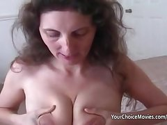 Lactating mature milks while giving excellent blowjob