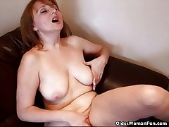 Busty nourisher rubs her mature clit