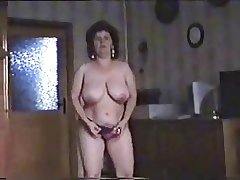 Admirable striptease of hairy mature bitch. Amateur older