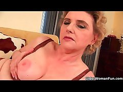 Granny with big bosom and hairy pussy fucks a dildo