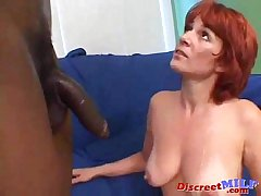 Redhead old lady gets big ebon cock