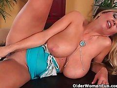 Magnificent milf with big tits fucks herself with a dildo